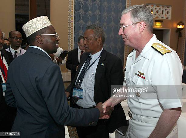 Transitional Federal Government of Somalia president Sheikh Sharif Ahmed shakes hands with US Vice Adm John W Miller commander of the fifth fleet at...