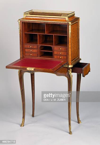 Transitional Louis XVLouis XVI style Second Empire secretary with rosewood satinwood and small Sevres porcelain plaque inlays created by L'Escalier...