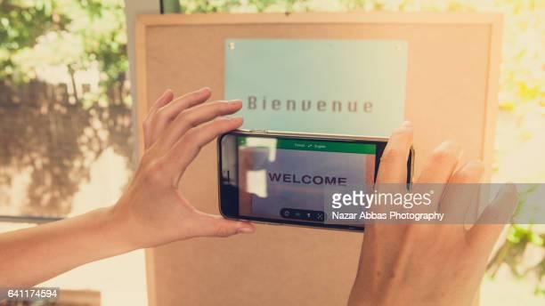 translation app. - english language stock pictures, royalty-free photos & images