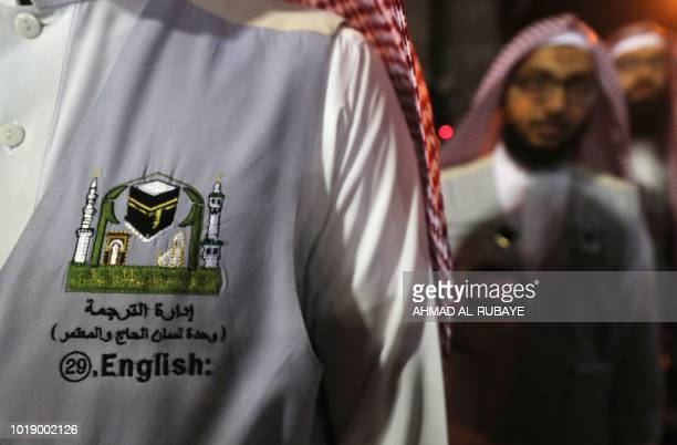 A translator waits to help Muslim pilgrims in the Saudi holy city of Mecca ahead of the start of the Hajj pilgrimage on August 17 2018 The sixday...