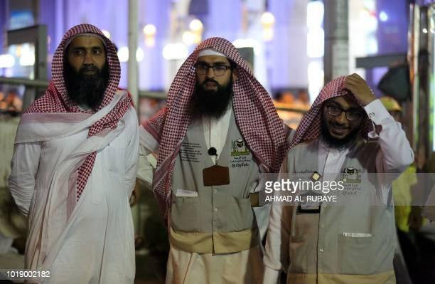 Translators wait to help Muslim pilgrims in the Saudi holy city of Mecca ahead of the start of the Hajj pilgrimage on August 17 2018 The sixday Hajj...