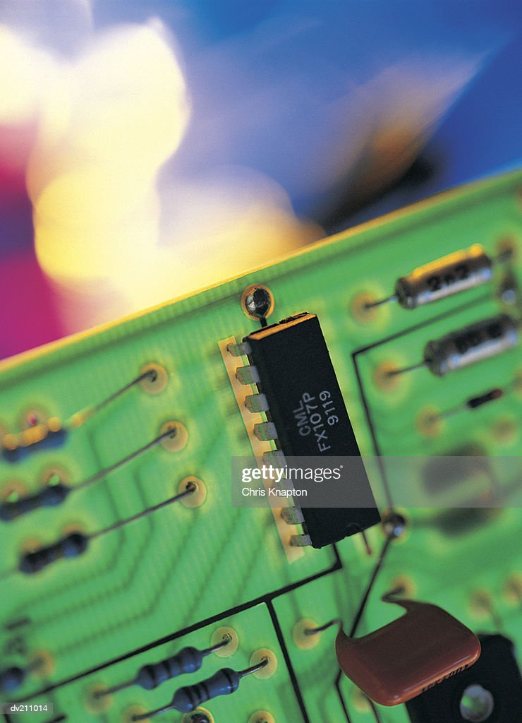 Translucent circuit board in front of variegated colors : Stock Photo
