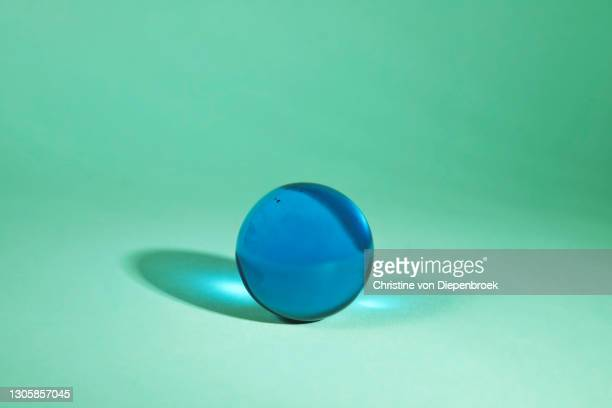 translucent shiny glass objects on plain background - sphere stock pictures, royalty-free photos & images