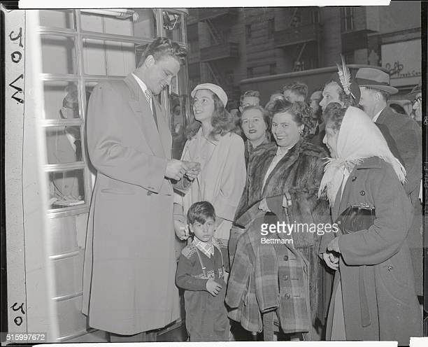 TransLux Theatre at 52nd and Lexington John Ericson buys first tickets for actress Pier Angeli at premiere of Teresa April 5 1951