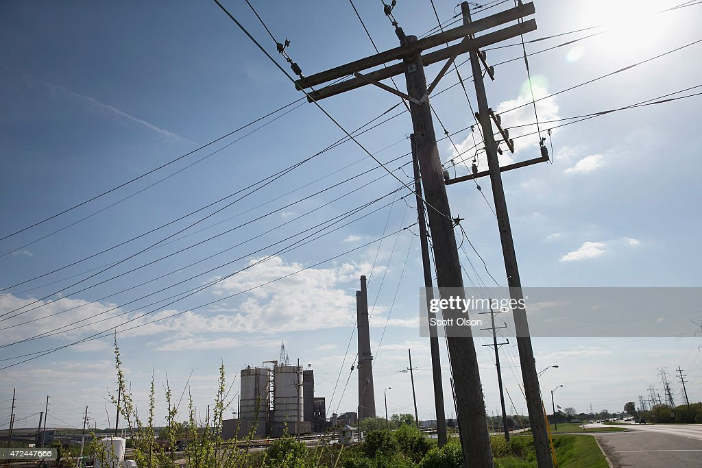 Transmission lines carry electricity from NRG Energy's Joliet Station power plant on May 7, 2015 in Joliet, Illinois. According to scientists, global carbon dioxide (CO2) concentrations have reached a new monthly record of 400 parts per million, levels that haven't been seen for about two million years. The Environmental Protection Agency (EPA) reports the combustion of fossil fuels to generate electricity is the largest single source of CO2 emissions in the United States, followed by the burning of fossil fuels for transportation.