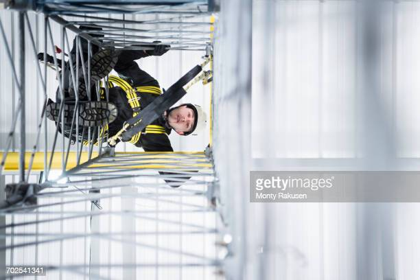 transmission tower engineer training to climb in training facility - telecommunications equipment stock photos and pictures