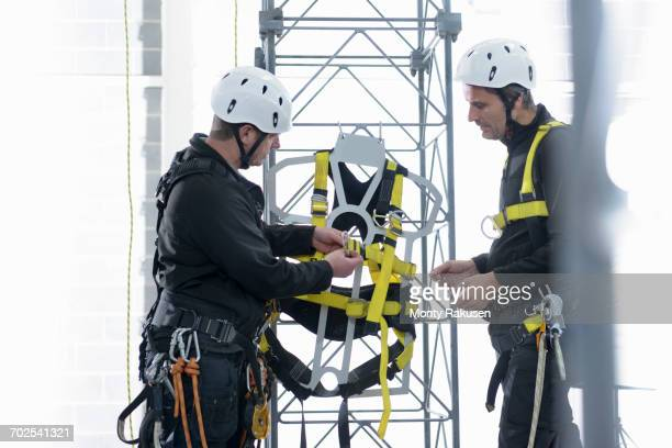 transmission tower engineers training in training facility - safety equipment stock pictures, royalty-free photos & images