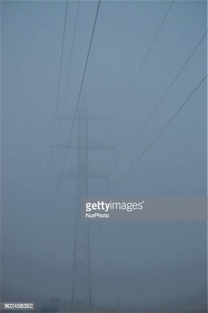 A transmission tower is displayed during heavy mist in the winter season in Ankara Turkey on January 8 2018