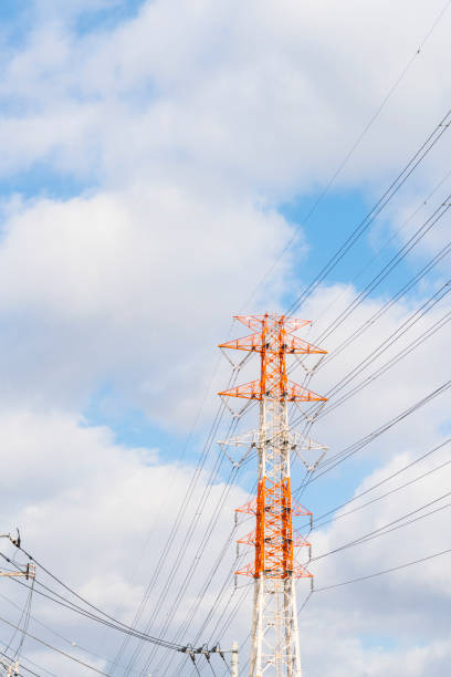 Transmission Tower stands under the white clouds in Japan.