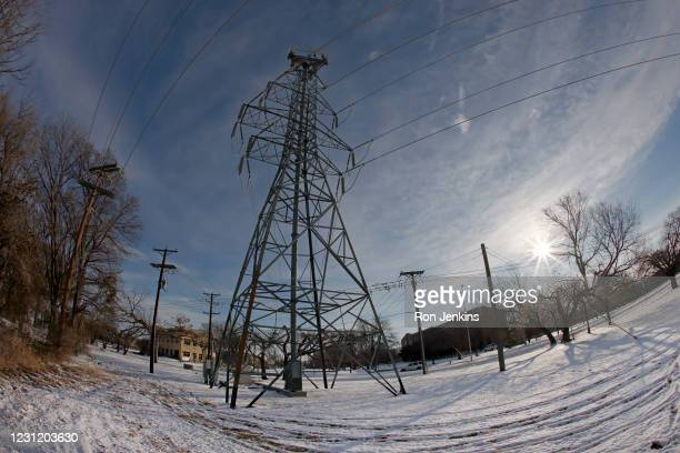 Transmission tower supports power lines after a snow storm on February 16, 2021 in Fort Worth, Texas. Winter storm Uri has brought historic cold...