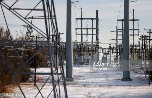 Transmission towers and power lines lead to a substation after a snow storm on February 16, 2021 in Fort Worth, Texas. Winter storm Uri has brought...