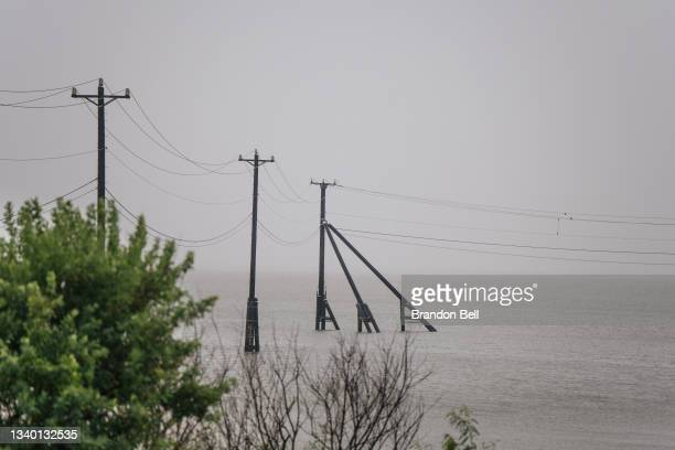 Transmission towers are shown ahead of the Tropical Storm Nicholas on September 13, 2021 in Galveston, Texas. A hurricane watch is in effect as...