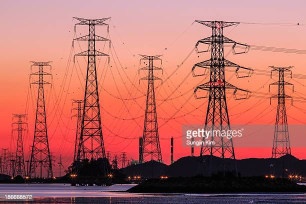 Transmission towers at sunset
