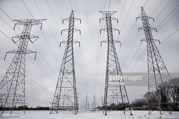 Transmission towers stand near the NRG Energy Inc Will County Generating Station a coalfired power plant in Romeoville Illinois US on Monday Jan 8...