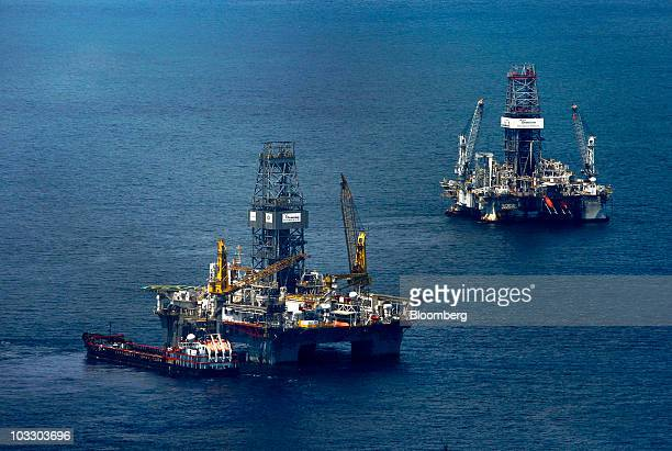 Transocean Ltd's Development Driller III rig left and Development Driller II rig work to drill relief wells at the BP Plc Macondo site in the Gulf of...