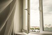 transparent curtain on open plastic window