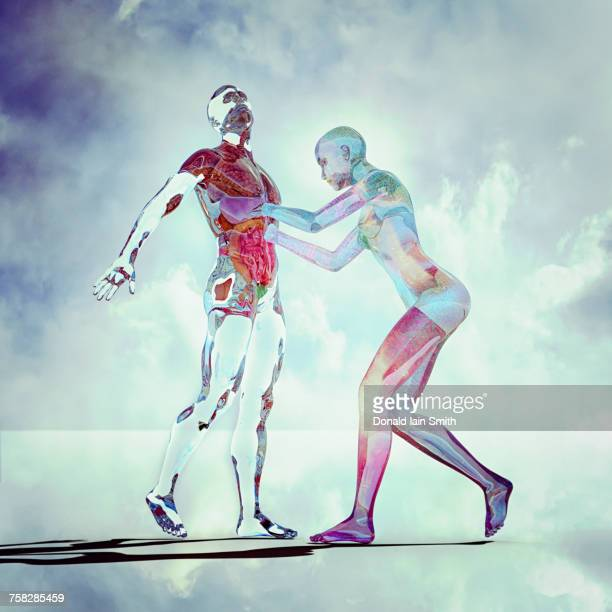 transparent futuristic woman reaching into abdomen of man - human stomach internal organ stock photos and pictures