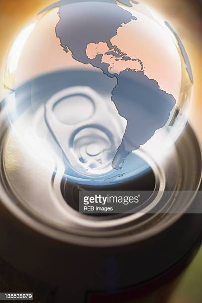 transparent globe hovering over aluminum can - tin can stock pictures, royalty-free photos & images