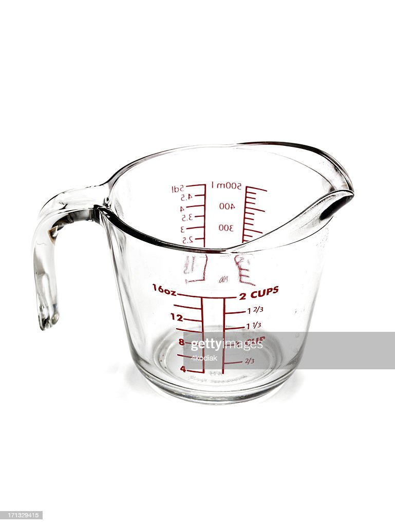 Transparent measuring cup isolated on white background : Stock Photo