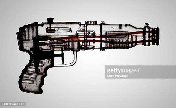 Transparent plastic water pistol, side view