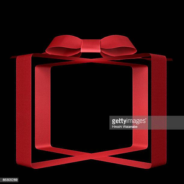 Transparent present wrapped by red ribbon