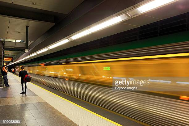 transperth electric train service departs perth underground station - perth stock pictures, royalty-free photos & images