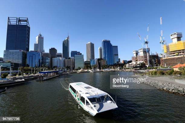 A Transperth ferry departs from Elizabeth Quay Jetty in the central business district of Perth Australia on Wednesday April 11 2018 Australia is...