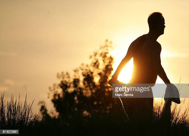 A transplant athlete stretches prior to the 5K run along the North Shore on July 13 2008 at the National Kidney Foundation US Transplant Games in...