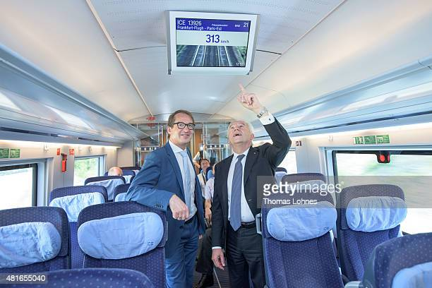 Transport and Digital Technologie Mininister Alexaner Dobrindt and Deutsche Bahn CEO Ruediger Grube look to a monitor in the new ICE 3 that shows the...