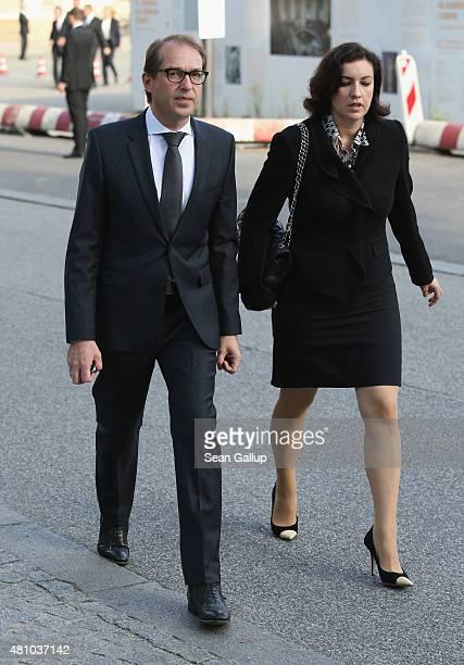 Transport and Digital Technologies Minister Alexander Dobrindt and politician Dorothee Baer arrive for a memorial service for recentlydeceased CDU...