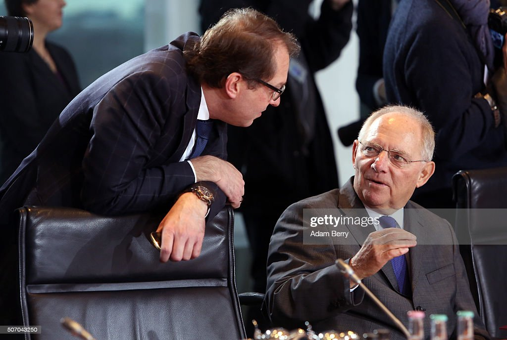 Transport and Digital Technologies Minister Alexander Dobrindt (CSU, L) and Finance Minister Wolfgang Schaeuble (CDU) arrive for the weekly German federal Cabinet meeting on January 27, 2016 in Berlin, Germany. High on the meeting's agenda was discussion of the country's annual business report.