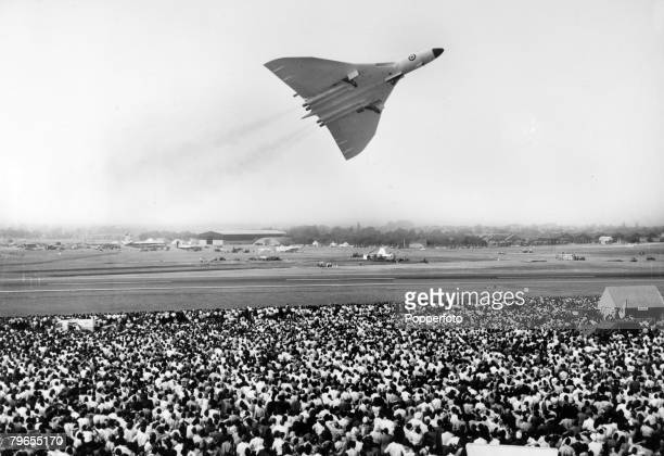 13th September 1959 Farnborough Air Show England A British Avro 'Vulcan' delta wing jet bomber excites the crowd at the Farnborough Air Show The...