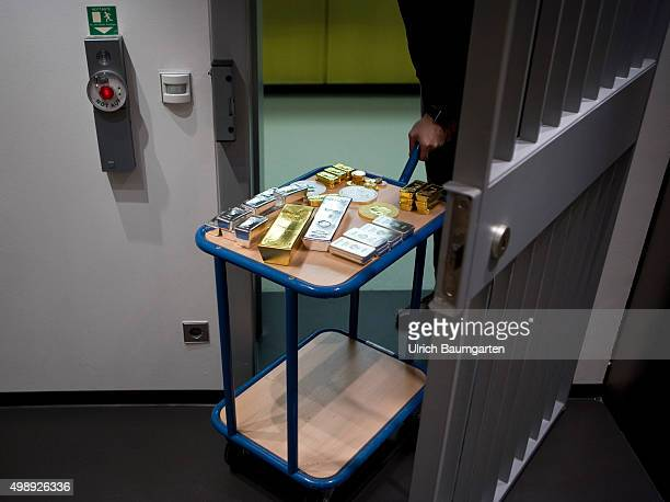 Transport carriages with gold bullions silver bullions and gold coins in the strong room of pro aurum goldhouse in Munich