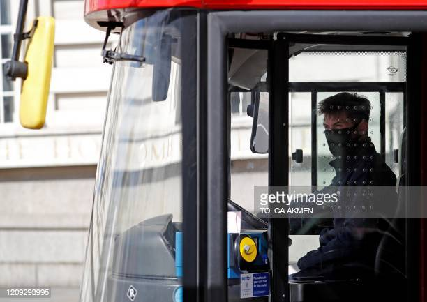 A Transport for London London Bus driver wearing a face mask as a precautionary measure against COVID19 drives their bus in London on April 6 as life...