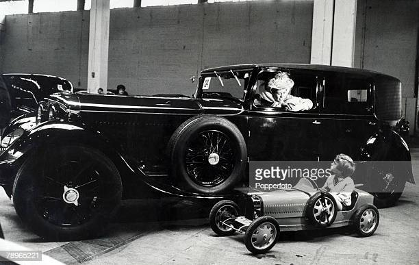 Transport London England A large Vintage Bentley 80 Litre Saloon car together with a electrically operated childs model car of a 1928 Bugatti car...