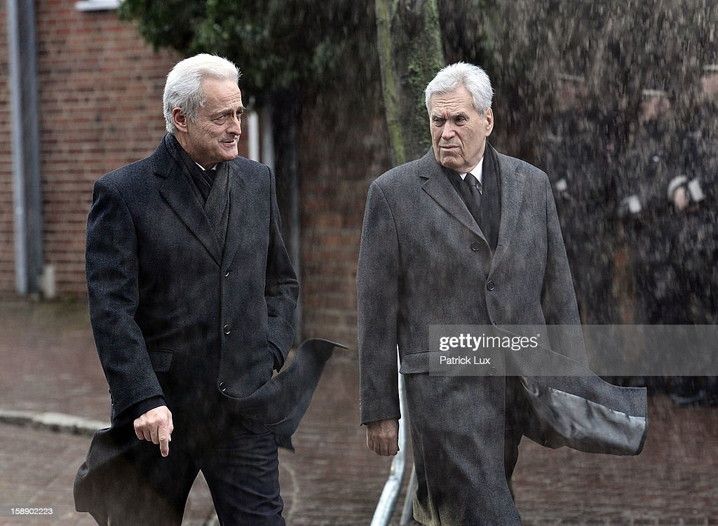 Transport Minister Peter Ramsauer (CSU) and former Economy Minister Michael Glos arrive at a memorial service for former German Defence Minister Peter Struck on January 3, 2013 in Uelzen, Germany. Struck was a leading member of the German Social Democrats (SPD) and died in December following a heart attack.