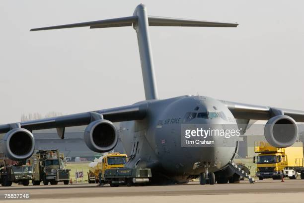 C17 transport plane and ground support at RAF Brize Norton in Oxfordshire United Kingdom