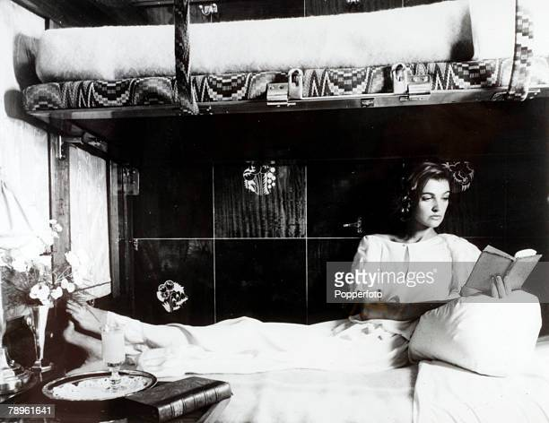 circa 1980 A woman 'lounges' in the sleeper compartment of the revived 'Orient Express which was about to start back in service