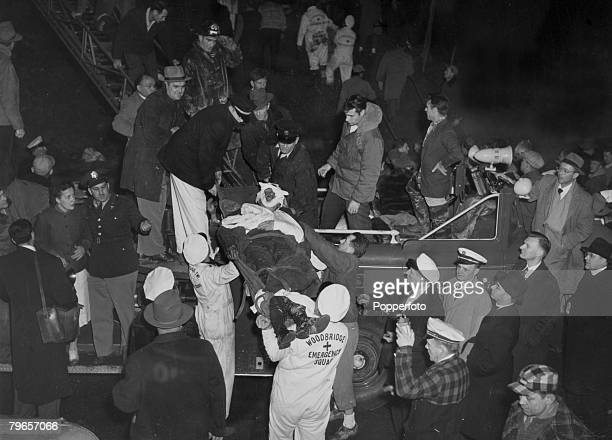 """Transport, Railways, Accidents, pic: 6th February 1951, Woodbridge, New Jersey, USA, Rescuers remove a badly injured person on a stretcher after """"The..."""