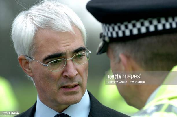 Transport Secretary Alistair Darling talks to Andy Trotter, the Deputy Chief Constable of British Transport Police during a visit to the wreckage of...