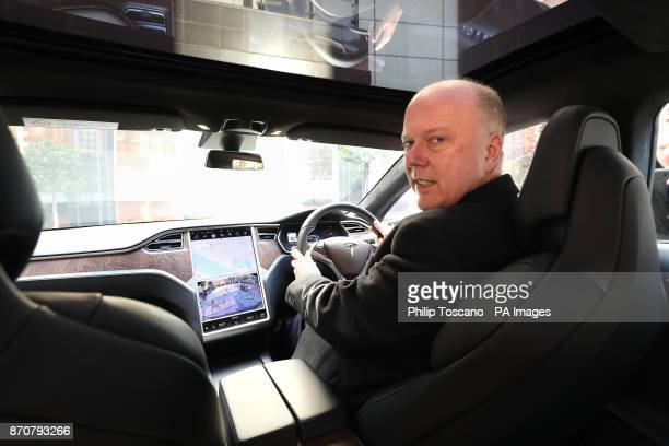 Transport Secretary Chris Grayling after arriving in a Tesla S car to give his keynote speech to the Association of British Insurers autonomous...