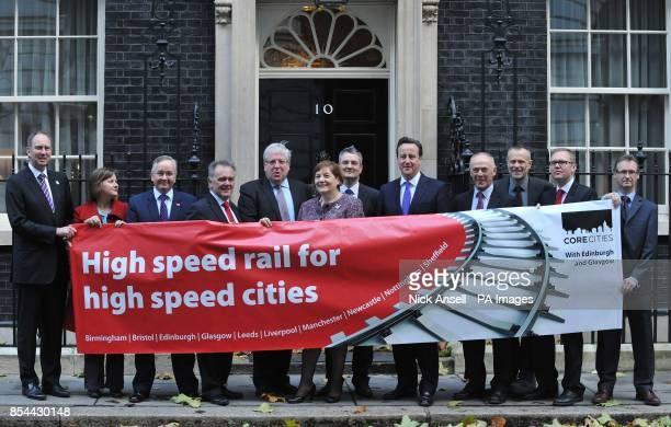 Transport Secretary Patrick McLoughlin and Prime Minister David Cameron with city representatives Liverpool Ged Fitzgerald Sheffield Cllr Julie Dore...