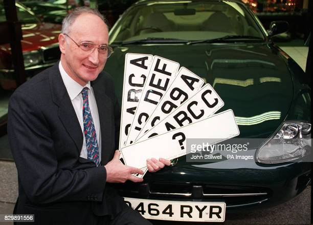 Transport Secretary Sir George Young holds up four registration plates in London this morning after launching a consultation document on possible...