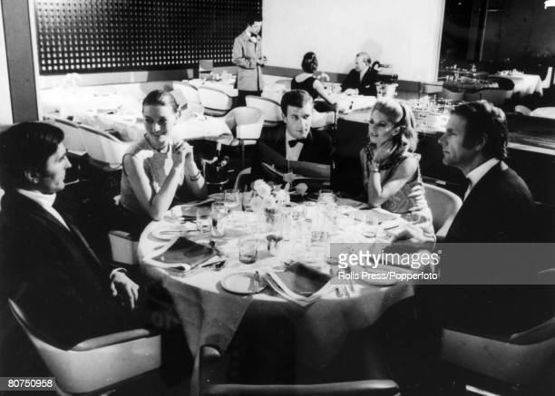 1969 Guests at a table in the Britannia Restaurant on the British liner Queen Elizabeth II The Queen Elizabeth II built at Clydebank Scotland made...