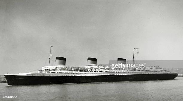 circa 1930's The French liner 'Normandie' pictured at sea The Normandie launched in 1932 and famous for it's lavish interiors was however not a...