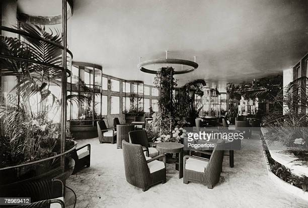 """Transport, Shipping, pic: circa 1930's, The Winter Garden on the French liner """"Normandie"""", The Normandie launched in 1932 and famous for it's lavish..."""