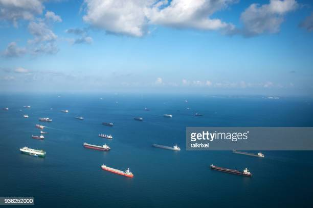 transport ships at the ocean, singapore - porto marittimo foto e immagini stock