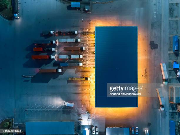transport station container trainer products at night. - transport stock pictures, royalty-free photos & images