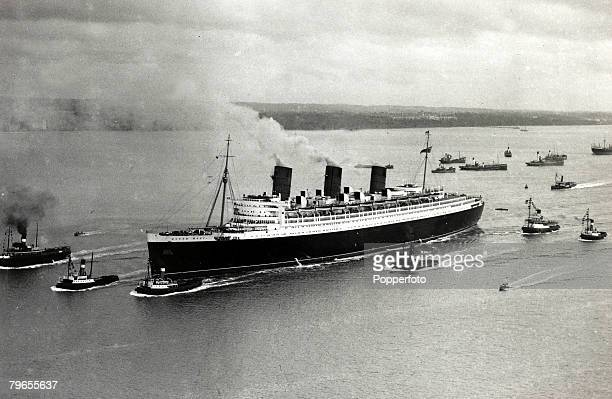 Transport / Travel Shipping Southampton pic 26th March 1936 The liner Queen Mary escorted by tugs as she heads for dry dock at Southampton where she...