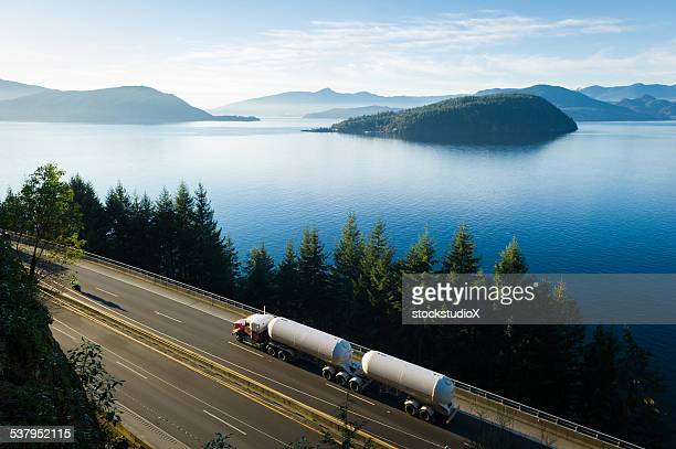transport truck driving along highway 99, bc, canada - north america stock pictures, royalty-free photos & images